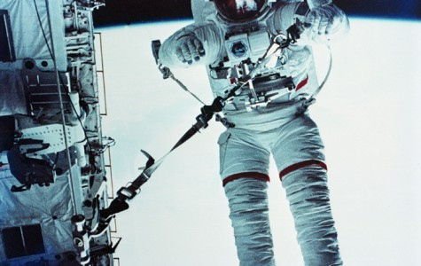 Astronaut F. Story Musgrave participates in a safety tether dynamics checkout procedure during the mission's April 7, 1983, extravehicular activity, otherwise known as EVA.  The earth is visible behind him.  (AP Photo/NASA)
