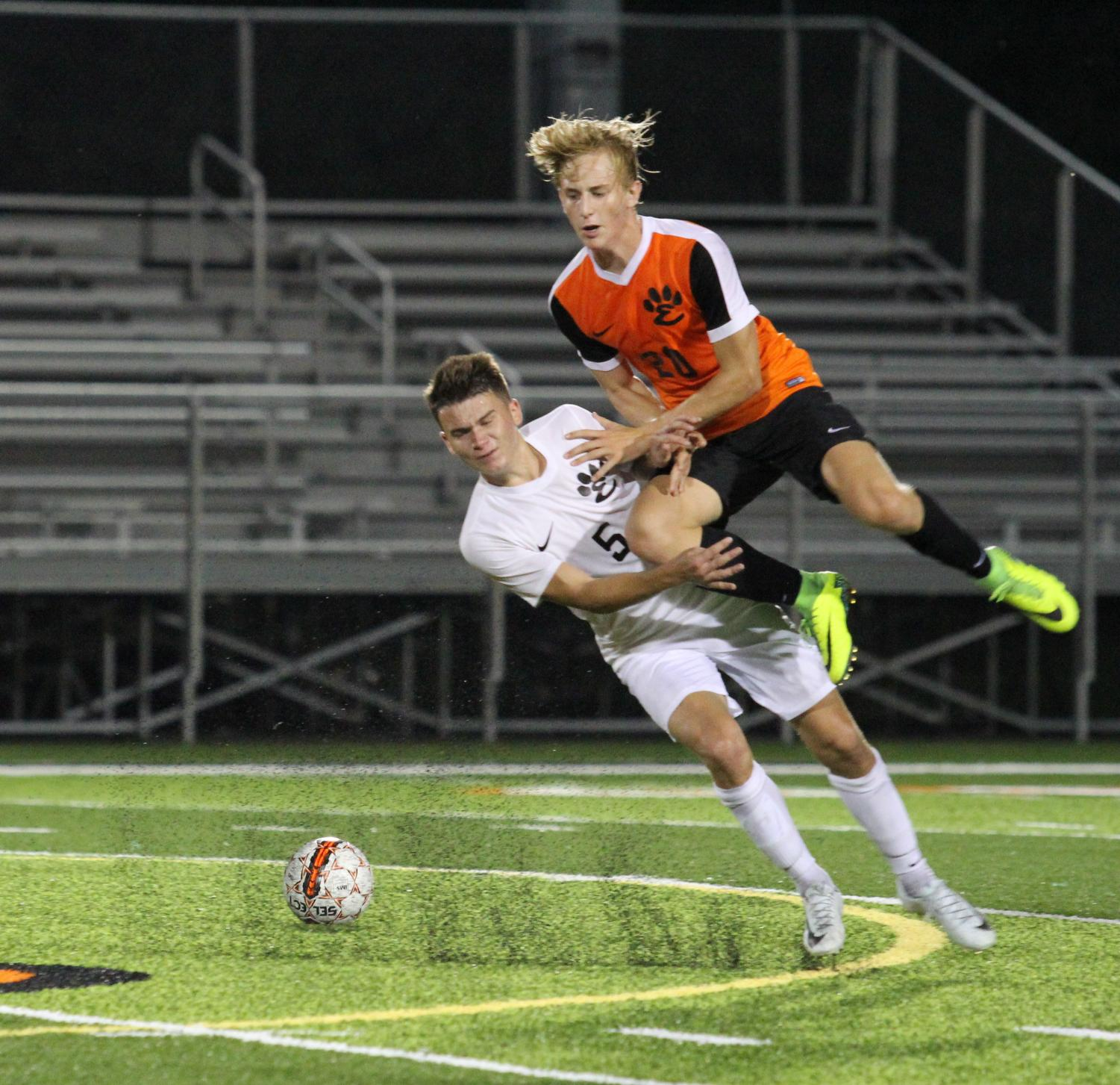 Junior Ashton Kaufman and Senior Bryce Broshow collide during the annual Orange and Black Scrimmage on Aug. 17.
