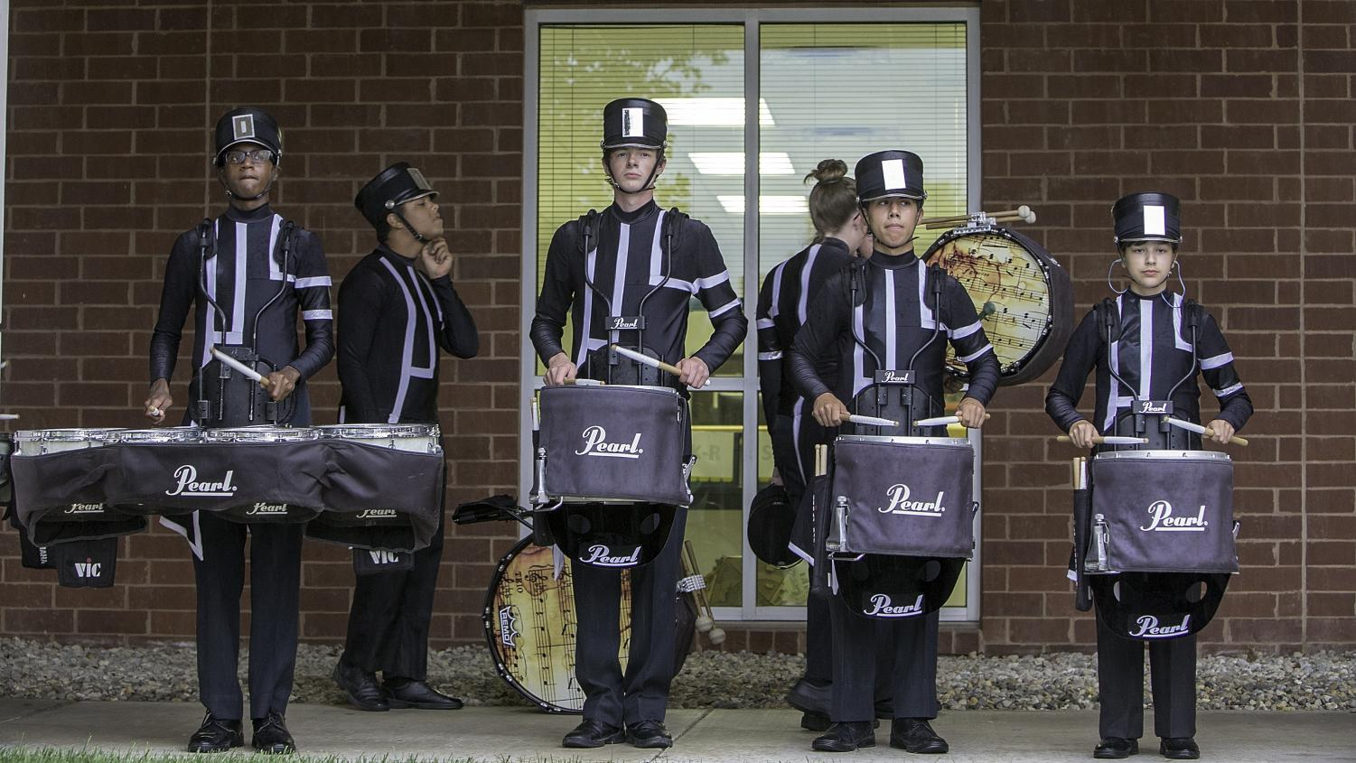 Marching band's percussion plays during the Tiger Prowl.