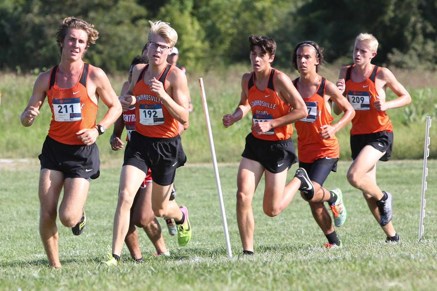 Senior Roland Prenzler, juniors Henry Gruben, Alexander Valdez, Jack Pifer and freshman Wyatt Erber lead the race around a corner at the SIUE cross-country course.