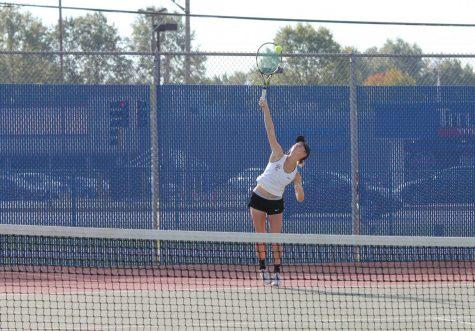 Girls Tennis Causing a Racket