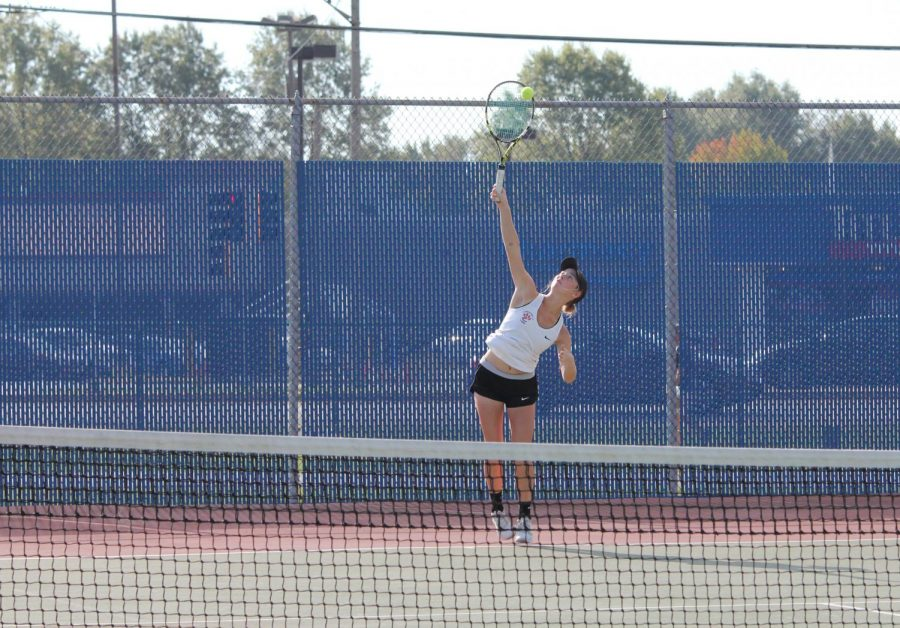 Senior+Annie+McGinnis+serves+the+ball+in+a+singles+match+against+Belleville+East.