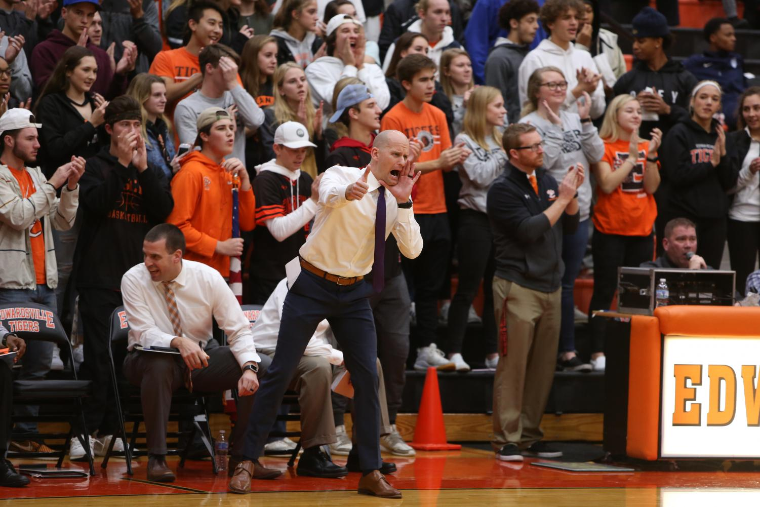 Coach Battas shouts at the basketball team in a home game this season.
