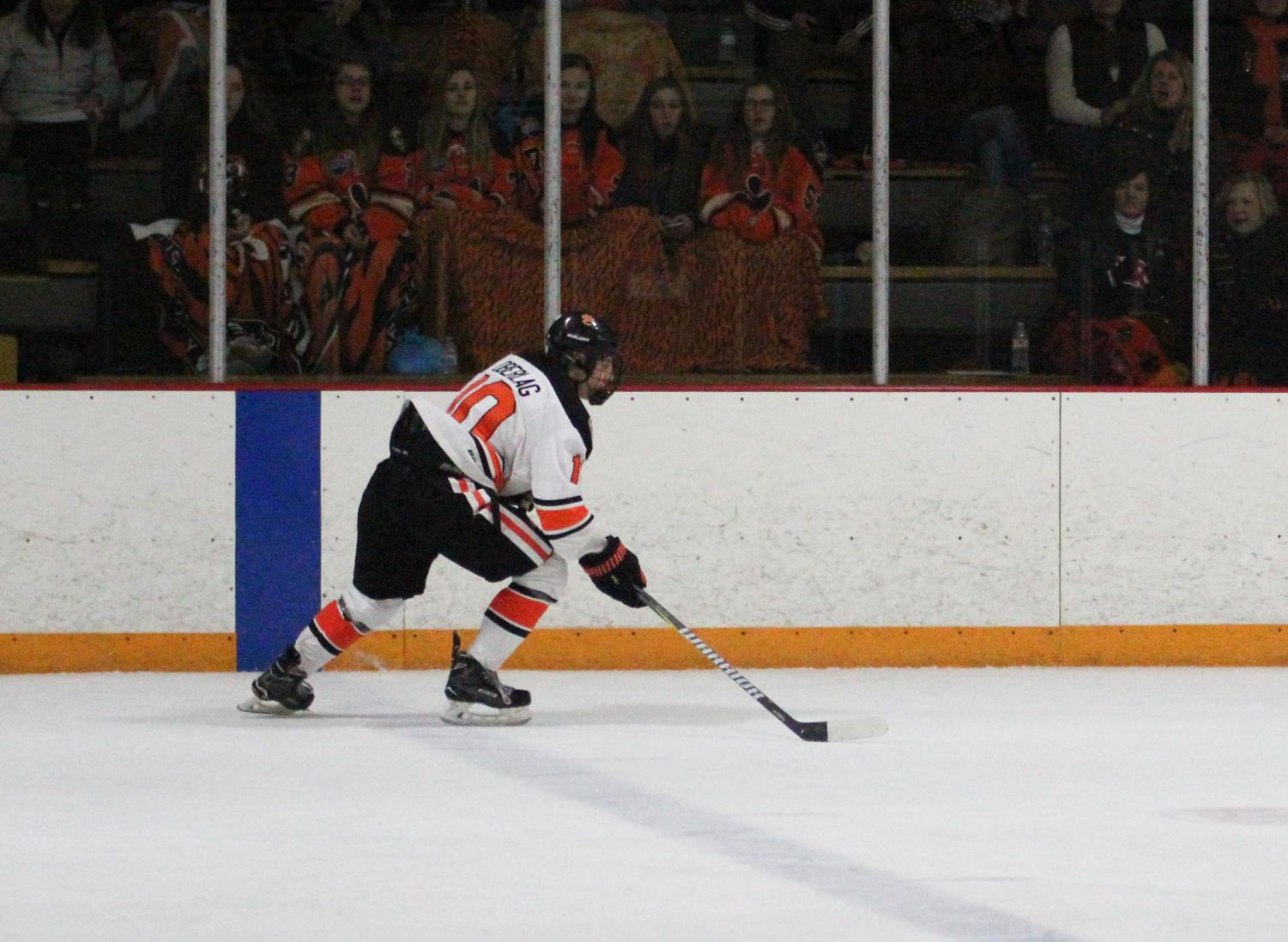 Senior captain Mitchell Oberlag skates across the rink.