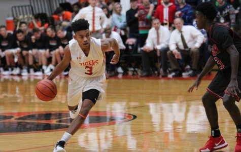 Senior Malik Robinson dribbles the ball down the court in a home game on Dec. 14.