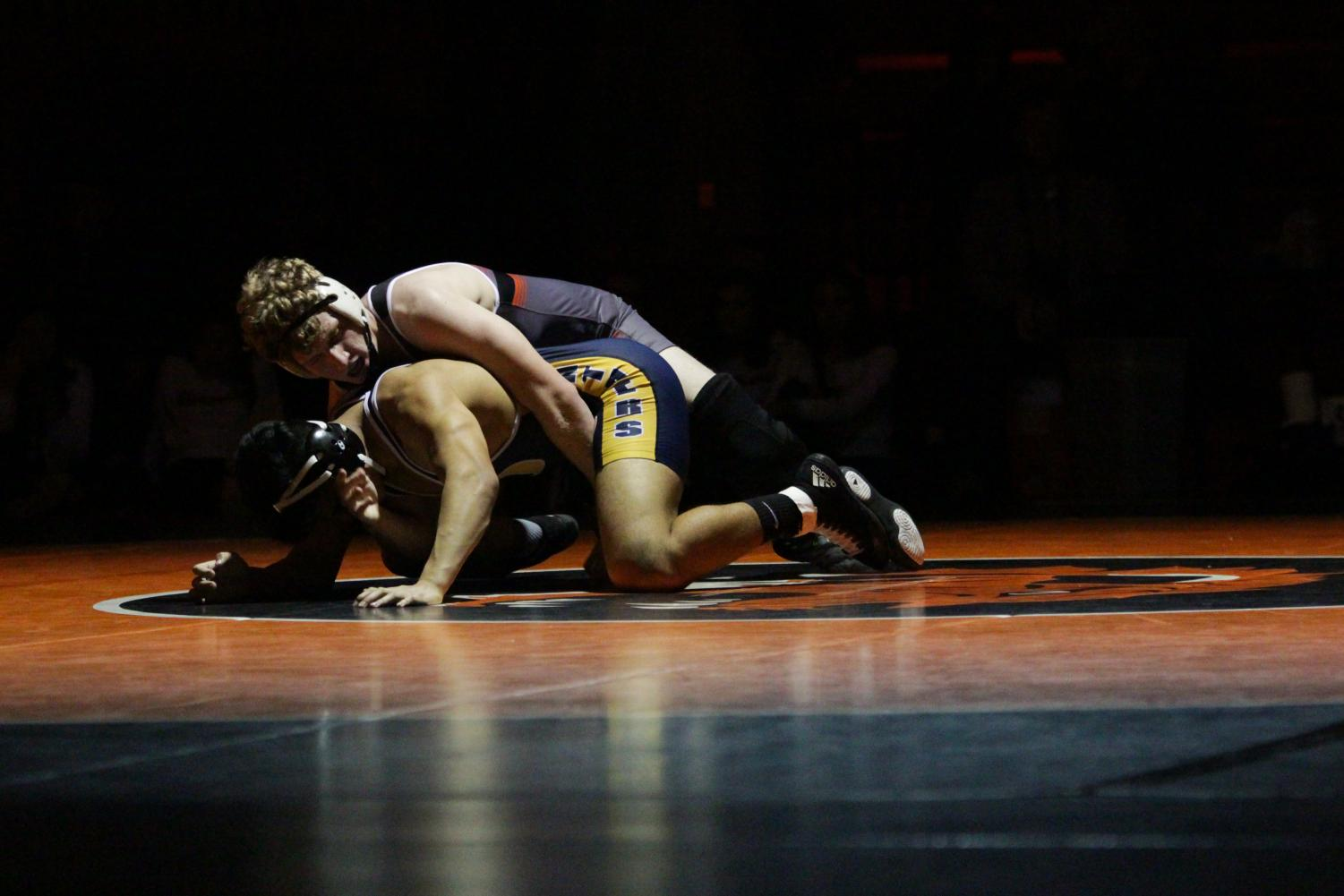 Senior Sam Martin tries to pin an opponent from O'Fallon Township High School on Dec. 29.