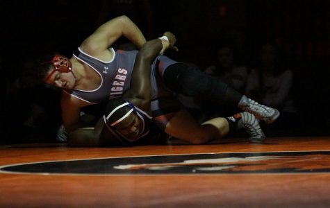 Senior Joshua Anderson pins an opponent from O'Fallon High School.