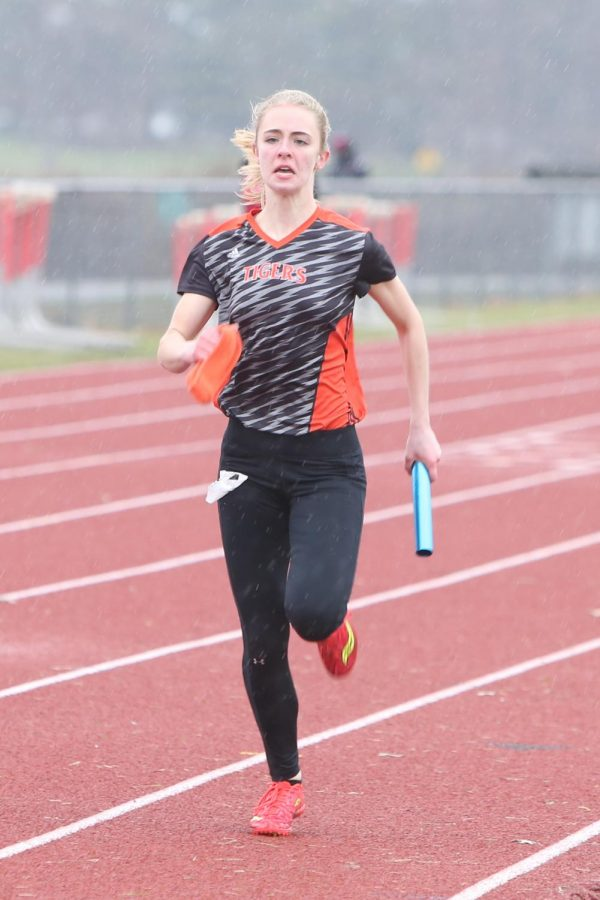Senior Rachel Kubicek sprints down the track in a relay last season.