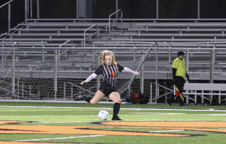 Senior Sarah Kraus sends the ball down the field.
