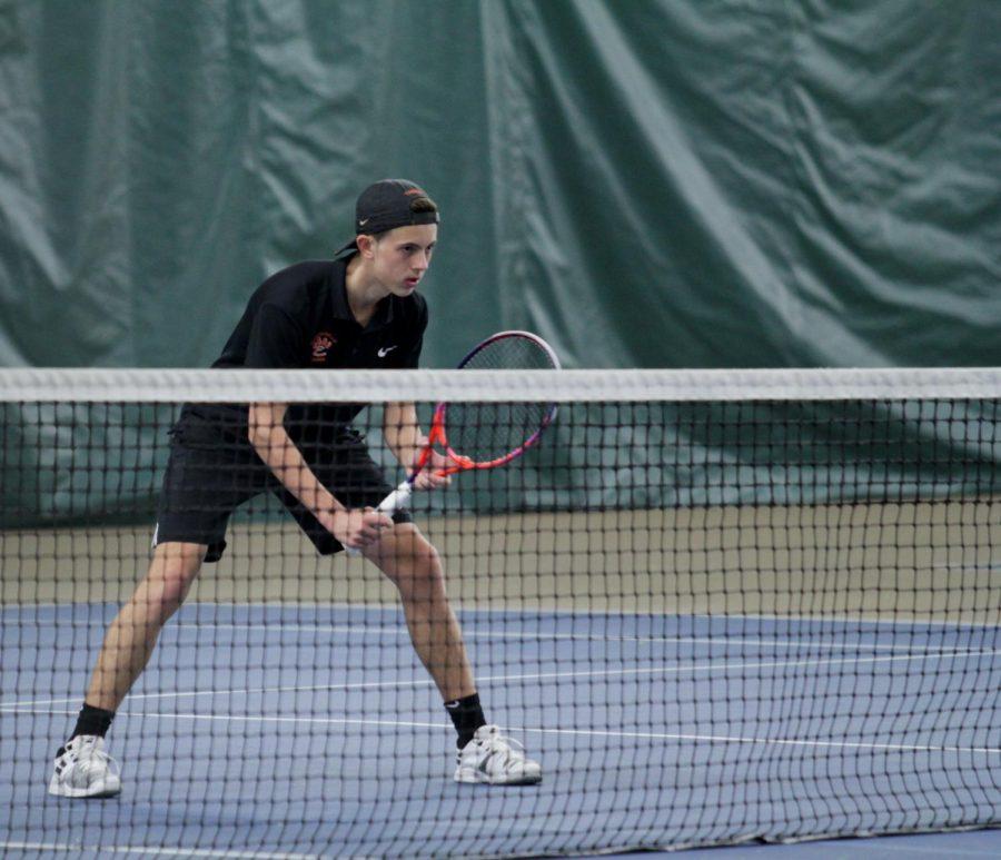 Senior+Drake+Schreiber+prepares+to+return+a+serve+on+at+a+match+on+April+1.