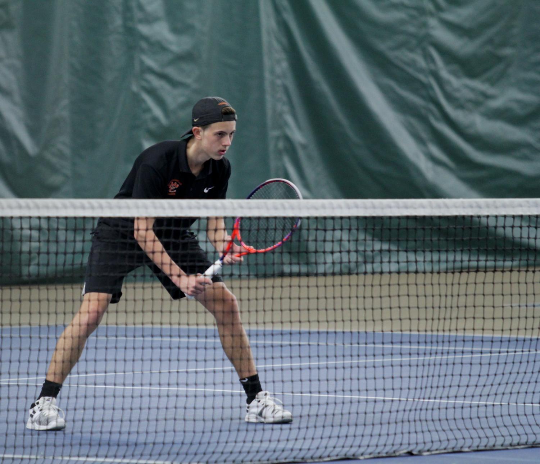Senior Drake Schreiber prepares to return a serve on at a match on April 1.