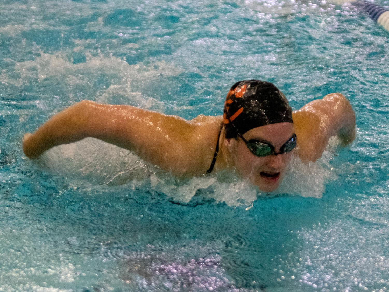 Freshman Josie O'Day swims the butterfly.
