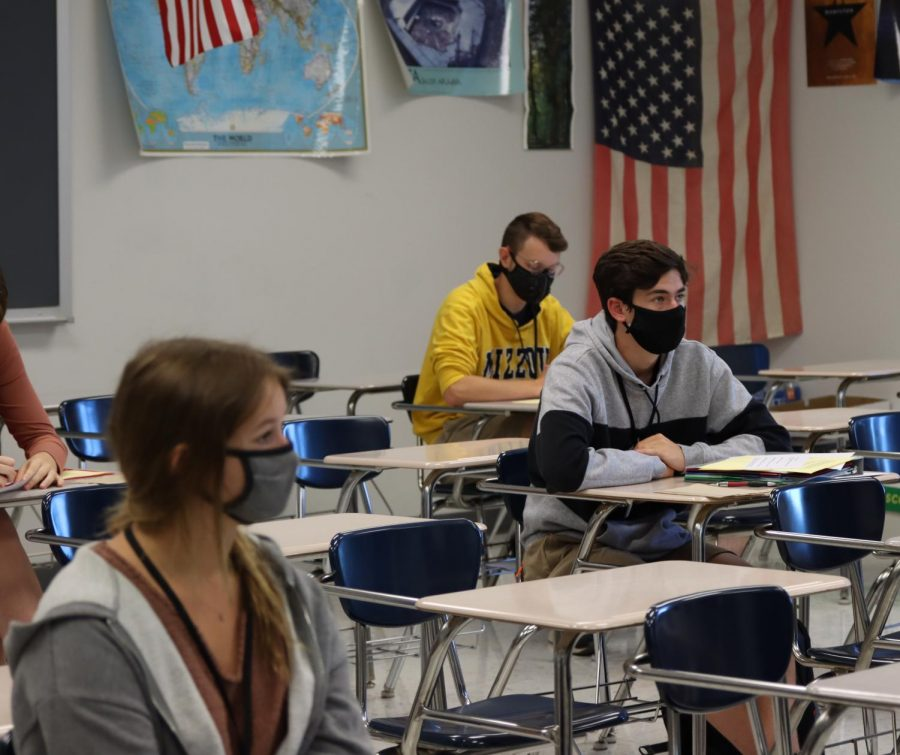 B-day students in a social studies class wait for instructions from their teacher. Approximately half of the student body attends classes in a given day.