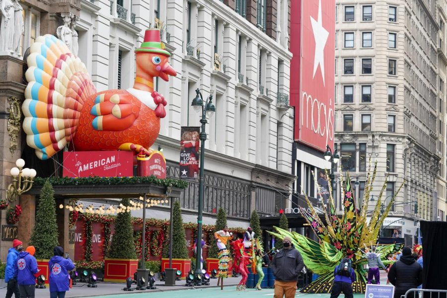 The Macy's Thanksgiving Day Parade took place despite COVID restrictions. Performers wore masks and no crowds were present to limit the spread.