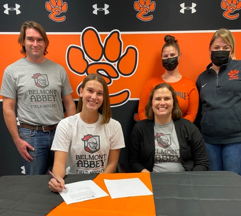 Senior Gabbi Trauernicht commits to play field hockey at Belmont Abbey with her parents and coaches at her side.
