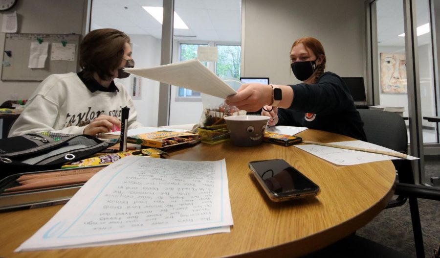 Sophomore Maddox Karnes and senior Grace Skiff work through their plan for the Yearbook Theme Development category. The duo had three hours to brainstorm a theme and both its verbal and visual components. The pair won first place.