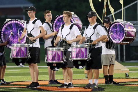 Senior Jack Busse, junior Will Dorsey, senior Carter Schwalb,  sophomore Sam Vuagniaux and senior Kaleb Hollis perform in the percussion line during the band