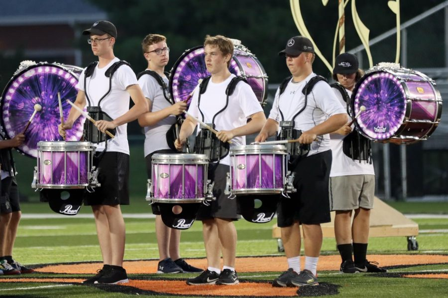 Senior Jack Busse, junior Will Dorsey, senior Carter Schwalb,  sophomore Sam Vuagniaux and senior Kaleb Hollis perform in the percussion line during the band's exhibition on Aug. 6. The show, titled
