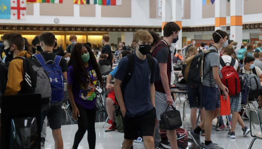 Students wait in cafeteria prior to the beginning of the school day on August 12.