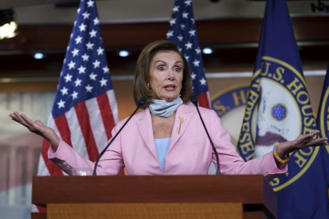 Nancy Pelosi addresses a crowd during a press conference.
