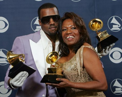 On Feb. 8, 2006, Kanye West and his late mother Donda West hold his three awards backstage at the 48th Annual Grammy Awards in Los Angeles.