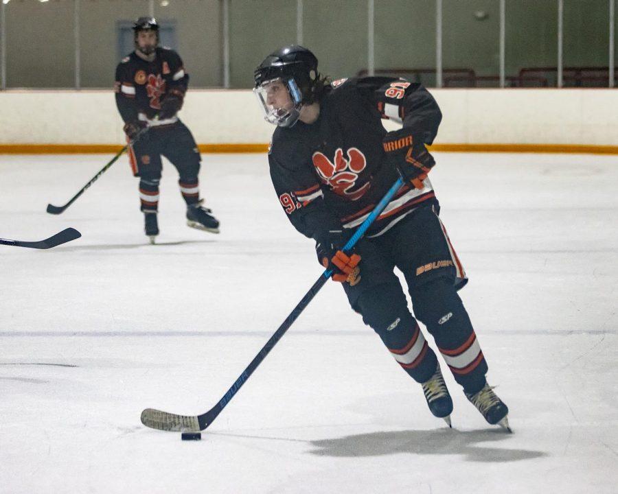 Seniors Luke Keth and Codi Klenke play in last year's hockey season