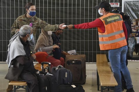 Afghan refugees receive aide at a German airport.