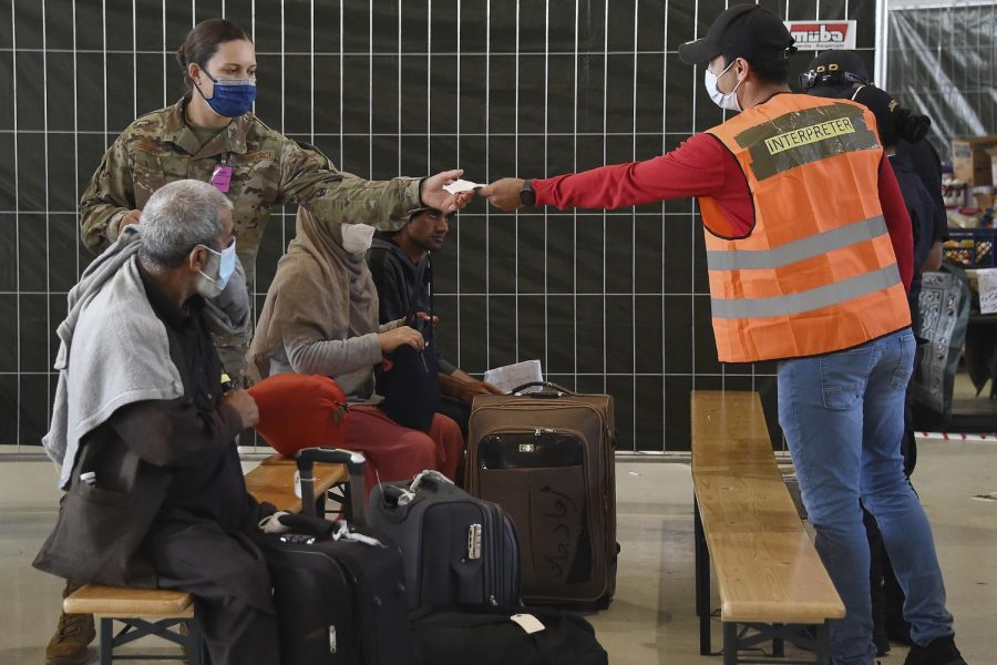 Afghan+refugees+receive+aide+at+a+German+airport.