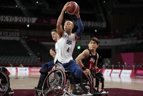 Paralympic basketball players fight for ball in the 2020 Paralympic games.
