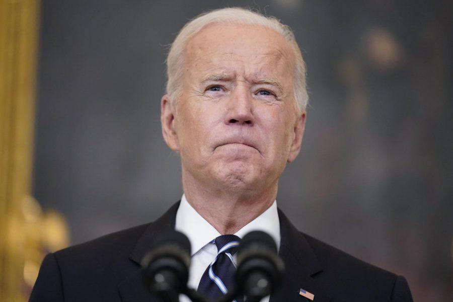 President Joe Biden addresses a crowd at a press conference.