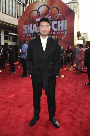 """Star of """"Shang-Chi,"""" Simu Liu on the red carpet at the movie"""