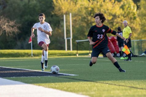 Junior Abe Gianaris defends against a Belleville West player at their Oct. 20 game.