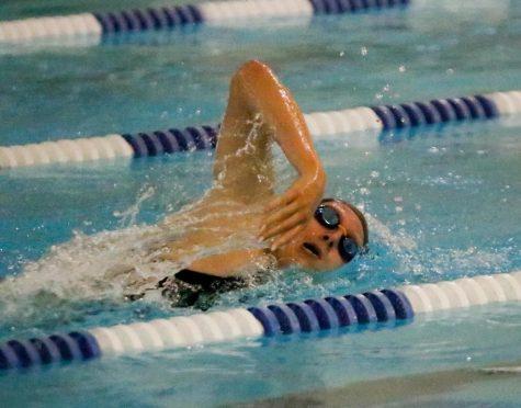 Senior Taylor Wilkerson swims in an August swim meet