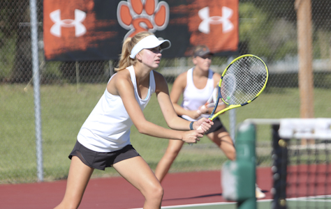 Sophomore Alyssa Wise waits for the ball in a home doubles match.