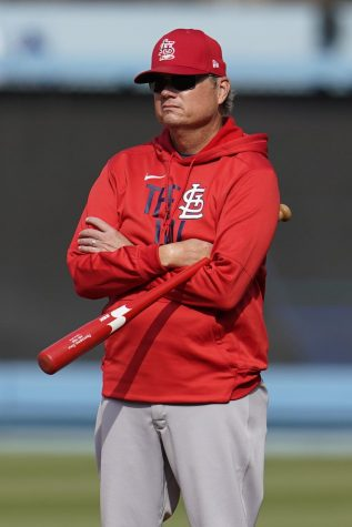 Former Cardinals manager Mike Shildt stands watch at a game